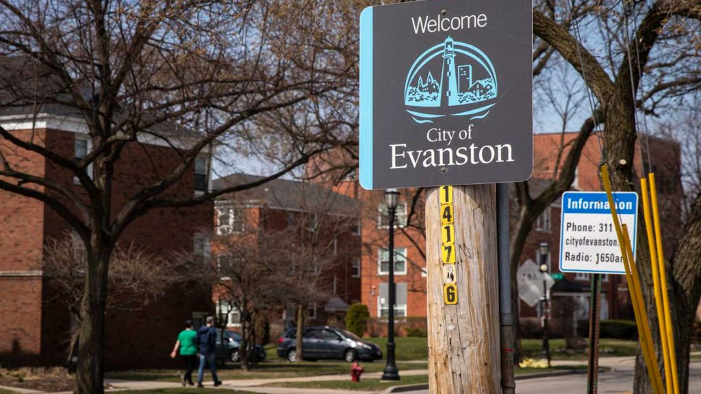 """A """"Welcome to Evanston"""" sign on Ridge Avenue at Howard Street. The city has the first municipally funded reparations program in the nation."""