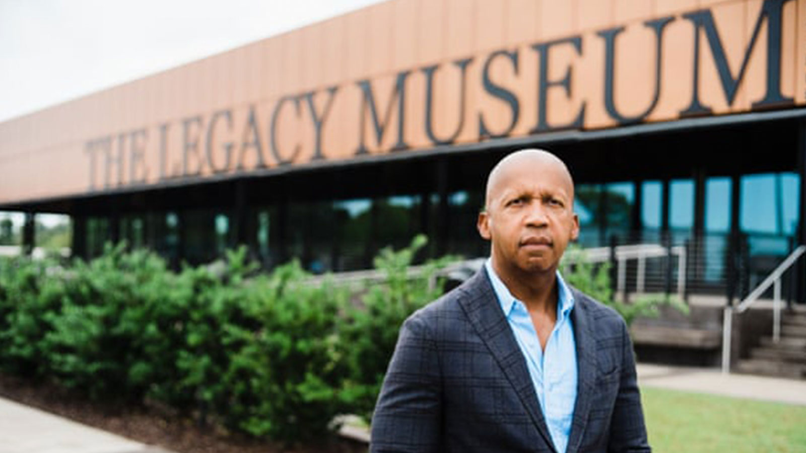 Bryan Stevenson, founder and executive director of the Equal Justice Initiative, stands outside The Legacy Museum.